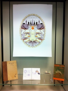 The Magic Voice print, with sketchbook and inspirational objects installed at the School of Museum Studies at the University of Leicester